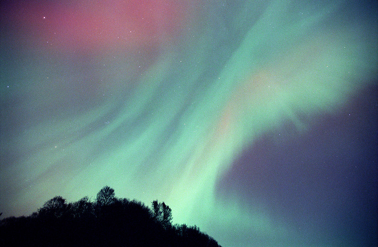 The aurora borealis, or northern lights, fill the night sky above the Kenai Peninsula near Clam Gulch, Alaska.