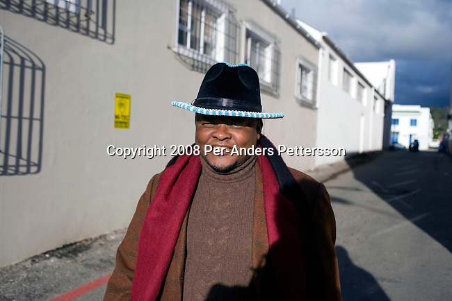 GRAHAMSTOWN, SOUTH AFRICA - JUNE 28: Zaki Makozoma, a businessman, walks in the city center on June 28, 2008, at the yearly arts festival in Grahamstown, South Africa. Mr. Macozoma, was sent to prison for 18 years for participating in terrorist activities during the struggle years. He was later freed and became the spokesperson for the ANC, and later became a multimillionaire, with interests primarily in the banking sector. Mr. Macozoma feels best when he visits Eastern Cape, the rural areas where he grew up. A traditional man, he likes to speak to the grass root people in these areas and he often visits local restaurants to eat a traditional meal such as sheep head and sheep feet. (Photo by: Per-Anders Pettersson/Getty Images).