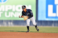 Charleston RiverDogs shortstop Ricky Surum (4) throws the ball to first base during a game against the Asheville Tourists at McCormick Field on May 22, 2019 in Asheville, North Carolina. The Tourists defeated the RiverDogs 10-8. (Tony Farlow/Four Seam Images)