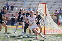 College Park, MD - April 27, 2019: Maryland Terrapins midfielder Erica Evans (33) looks to pass the ball during the game between John Hopkins and Maryland at  Capital One Field at Maryland Stadium in College Park, MD.  (Photo by Elliott Brown/Media Images International)