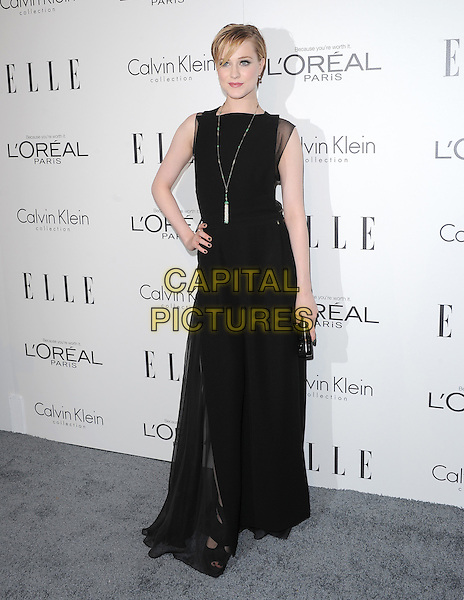 Evan Rachel Wood.18th Annual ELLE Women in Hollywood celebration held at The Four Seasons in Beverly Hills, California, USA..October 17th, 2011.full length black sleeveless necklace sheer dress hand on hip clutch bag.CAP/RKE/DVS.©DVS/RockinExposures/Capital Pictures.