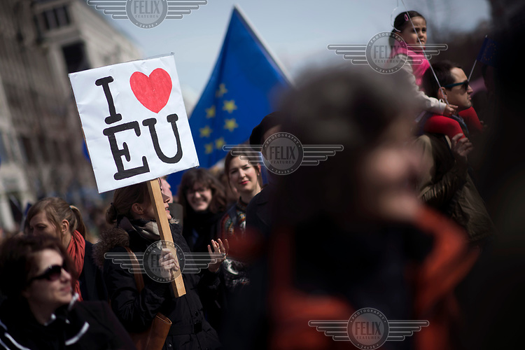 A woman holds an 'I love EU' placard at a pro-EU rally, the 'March for Europe', organised by the European Movement to celebrate the 60th anniversary of the Treaty of Rome.
