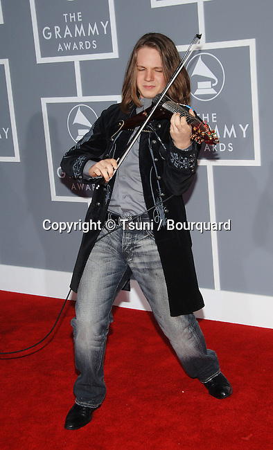 Antonio Pontarelli arriving at the 49th Annual Grammy's  at the Staples Center in Los Angeles. February 11, 2007.<br /> <br /> eye contact<br /> full lenght<br /> smile