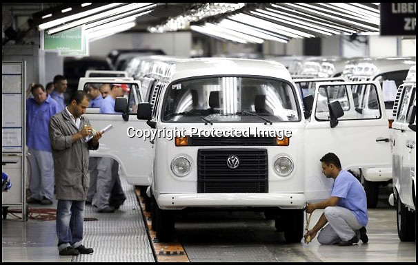 BNPS.co.uk (01202 558833)<br /> Pic: Danbury/BNPS<br /> <br /> ****Please use full byline****<br /> <br /> VW factory.<br /> <br /> The last ever delivery of brand new Volkswagen campervans has arrived in Britain marking the end of an era for the iconic 'hippy bus'.<br /> <br /> Ninety nine of the final batch of vans rolled off the production line and onto a container ship bound for British shores after manufacture ceased for good in Brazil in December.<br /> <br /> And though the consignment has only just arrived, almost all of the vans have already been snapped up by eager buyers happy to fork out the &pound;35,000 starting price.<br /> <br /> They are the last brand new campers in all of Europe.