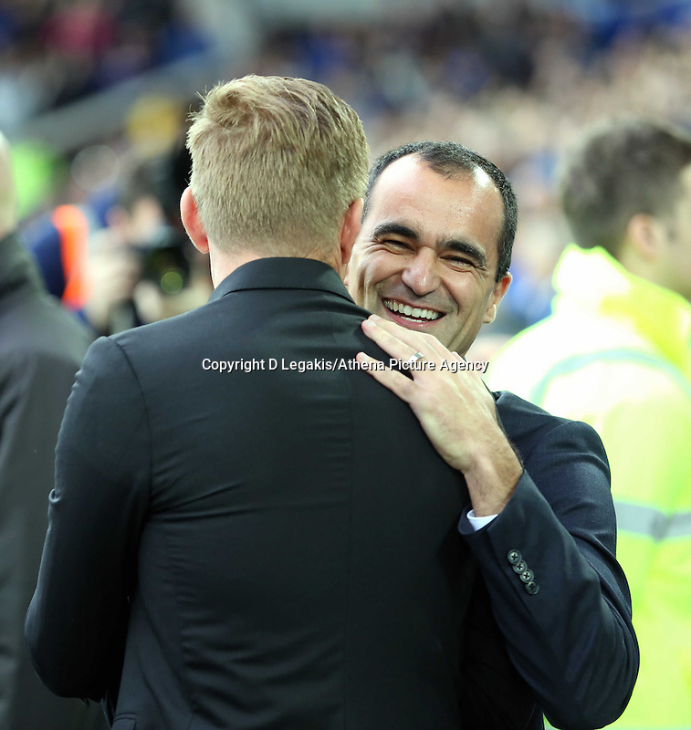 Liverpool, UK. Saturday 01 November 2014<br /> Pictured L-R: Swansea manager Garry Monk greets former team mate and Everton manager Roberto Martinez.<br /> Re: Premier League Everton v Swansea City FC at Goodison Park, Liverpool, Merseyside, UK.