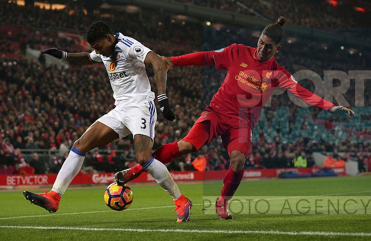 Patrick van Aanholt of Sunderland tussles with Roberto Firmino of Liverpool during the Premier League match at the Anfield Stadium, Liverpool. Picture date: November 26th, 2016. Pic Simon Bellis/Sportimage