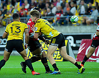 Jordie Barrett tackles Jordan Taufua during the Super Rugby match between the Hurricanes and Crusaders at Westpac Stadium in Wellington, New Zealand on Friday, 29 March 2019. Photo: Dave Lintott / lintottphoto.co.nz