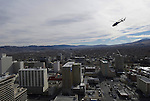 In this photo provided by the Reno Sparks Convention and Visitor's Authority, a helicopter circles the Silver Legacy Resort and Casino with Shane McConkey, a long time star of ski action movies who pioneered ski BASE jumping off giant cliffs in Europe who was set to perform the first-ever urban Ski-BASE jump off the roof of the Silver Legacy hotel casino in downtown Reno, Nev., Saturday Nov. 17, 2007. The stunt was to promote the local premier of the 2007 Warren Miller ski movie Playground and to raise money for the Make-a-Wish foundation, which helps make wishes come true for seriously ill children.
