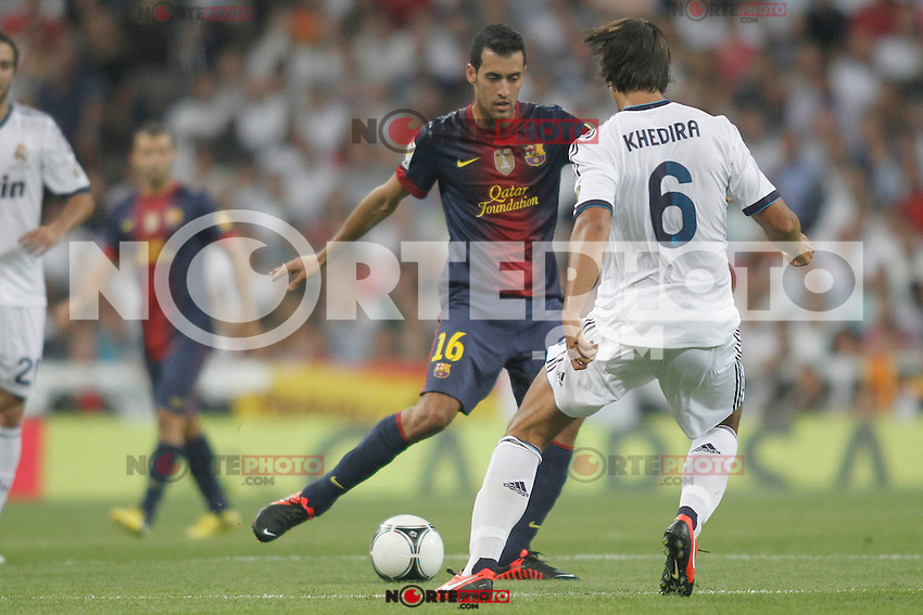 Real Madrid's Khedira and Barcelona's Sergio Busquets during Super Copa of Spain on Agost 29th 2012...Photo:  (ALTERPHOTOS/Ricky) Super Cup match. August 29, 2012. <br />