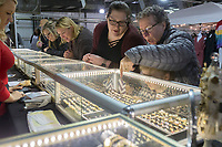 NWA Democrat-Gazette/CHARLIE KAIJO Pam McGuire (right) and Bobbi White of Garfield (second from right) look at jewelry during the Vintage Market Days event, Saturday, April 13, 2019 at the Benton County Fairgrounds in Bentonville.