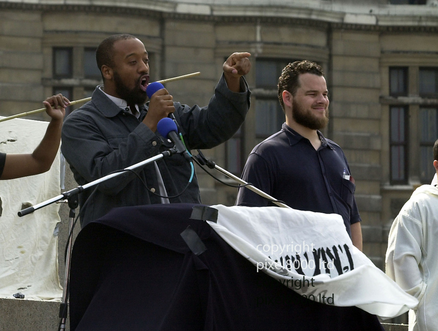 Pic shows: Muslim Islamic rally in Trafalgar Square 2002 - Simon Keeler and Trevor Brooks<br /> <br /> <br /> Simon Keeler and Trevor Brooks were both there together<br /> <br /> Simon Keeler seen surrounded by police and handcuffed presumably arrested.<br /> <br /> Brooks was also spoken too by police.<br /> <br /> <br /> Brooks is also known as Abu Izzadeen<br /> <br /> Keeler is also known as Sulayman Keeler<br /> <br /> <br /> <br /> <br /> <br /> Due for sentencing at Old Bailey today by video link<br />  after being arrested in Hungary fleeing the UK in the wake of the Paris attacks.<br /> <br /> <br /> <br /> <br /> picture by Gavin Rodgers/ Pixel8000