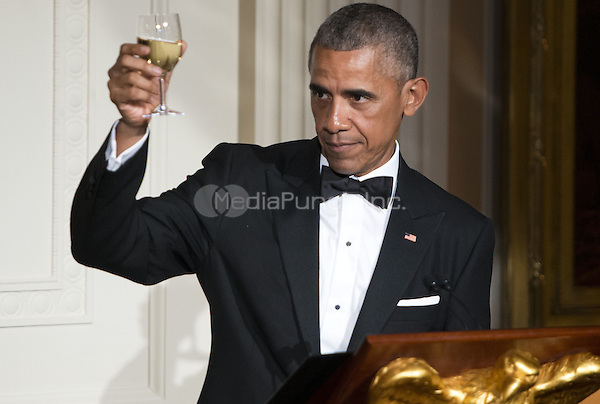 United States President Obama makes a toast in honor of Prime Minister Lee Hsien Loong in the East Room of the White House in Washington, DC on Tuesday, August 2, 2016.<br /> Credit: Leigh Vogel / Pool via CNP/MediaPunch