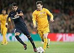FC Barcelona's Leo Messi (r) and  Atletico de Madrid's Augusto Fernandez during Champions League 2015/2016 match. April 5,2016. (ALTERPHOTOS/Acero)