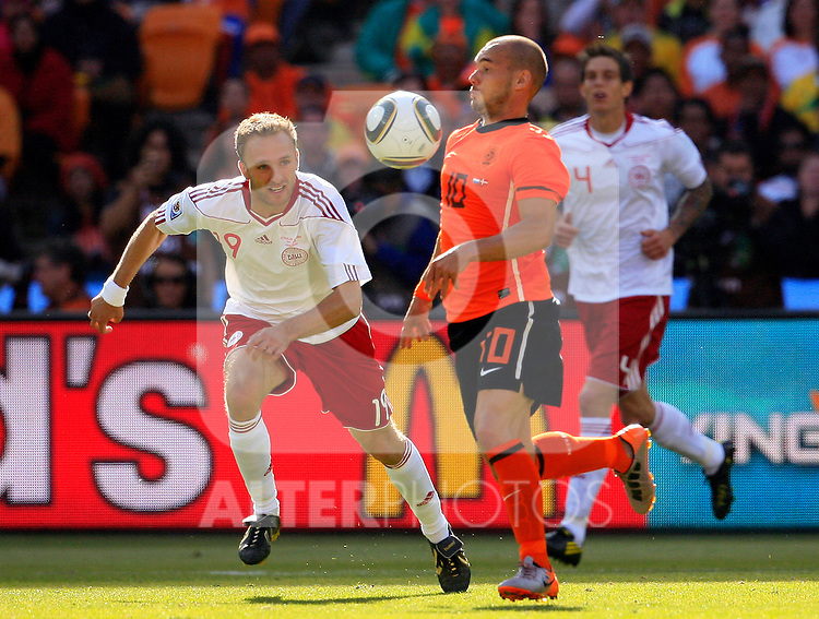 Dennis Rommedahl and Wesley Sneijder (10) Soccer Football - 2010 FIFA World Cup - Group E - Netherlands v Denmark Johannesburg Soccer City Stadium South Africa, Monday, June 14, 2010.
