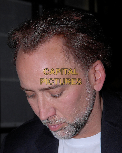 NICOLAS CAGE.Leaving the Dorchester Hotel, London, England, UK, March 24th 2009..portrait headshot dyed hair beard grey gray facial hair profile balding looking down white t-shirt.CAP/IA.©Ian Allis/Capital Pictures