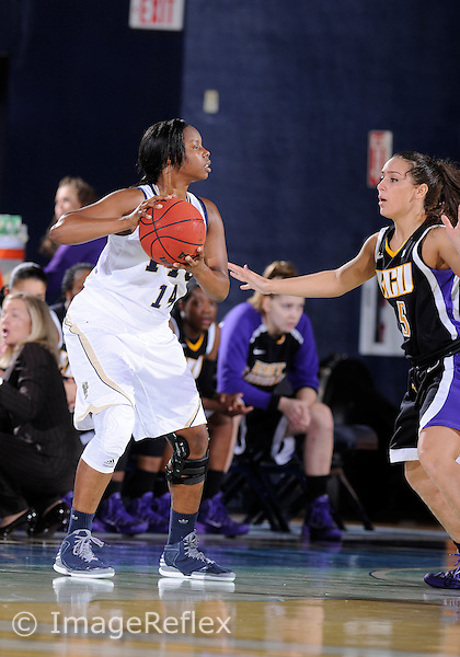 Florida International University guard Kamika Idom (14) plays against East Carolina University. FIU won the game 76-75 in overtime on January 11, 2014 at Miami, Florida.
