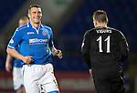 St Johnstone v Motherwell....25.02.14    SPFL<br /> James Dunne has a wry smile after a push and shove with Iain Vigurs<br /> Picture by Graeme Hart.<br /> Copyright Perthshire Picture Agency<br /> Tel: 01738 623350  Mobile: 07990 594431