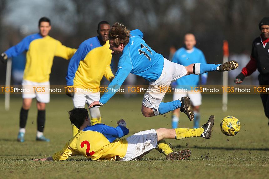 Wenlock Arms (yellow) vs FC Status - Hackney & Leyton Sunday League Football at South Marsh, Hackney Marshes, London - 19/02/12 - MANDATORY CREDIT: Gavin Ellis/TGSPHOTO - Self billing applies where appropriate - 0845 094 6026 - contact@tgsphoto.co.uk - NO UNPAID USE.