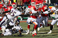 Chiefs Dante Hall (82) returns the opening kickoff 35 yards escaping the grasp of Baltimore cornerback Evan Oglesby (25) and linebacker Gary Stills (56) at Arrowhead Stadium in Kansas City, Missouri on December 10, 2006.