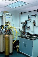 LABORATORY WATER DEIONIZER FILTRATION SYSTEM<br /> Ion, Primary &amp; Antibacterial Filters &amp; Storage Vat<br /> System also includes Ultraviolet Disinfection.  Deionized water has a practical pH value of 7.0 and is used for pure reagents in scientific experiments, sterile biological growth media &amp; extensively in the semiconductor industry.