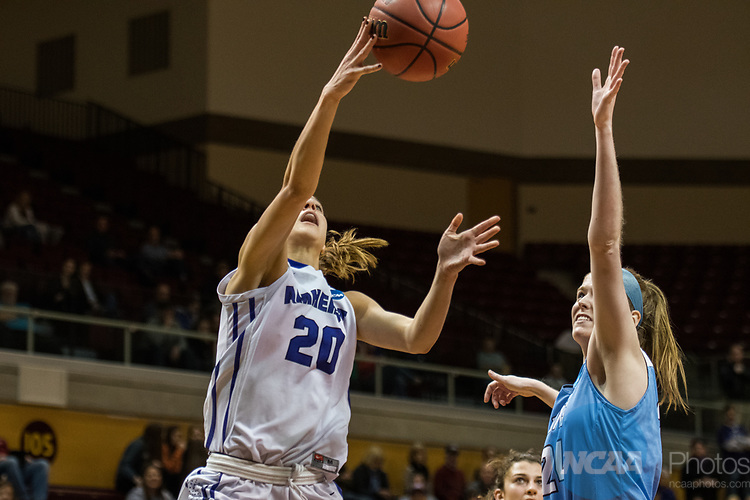 GRAND RAPIDS, MI - MARCH 18: Hannah Hackley (20) of Amherst College goes for the shot against Michela North (24) during the Division III Women's Basketball Championship held at Van Noord Arena on March 18, 2017 in Grand Rapids, Michigan. Amherst College defeated Tufts University 52-29 for the national title. (Photo by Brady Kenniston/NCAA Photos via Getty Images)