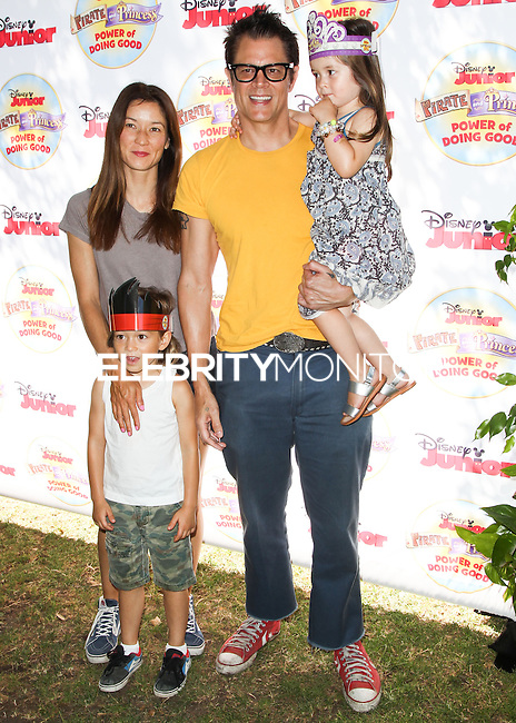 PASADENA, CA, USA - AUGUST 16: Arlo Clapp, Naomi Nelson, Johnny Knoxville, Madison Clapp at the Disney Junior's 'Pirate And Princess: Power Of Doing Good' Tour held at Brookside Park on August 16, 2014 in Pasadena, California, United States. (Photo by Celebrity Monitor)
