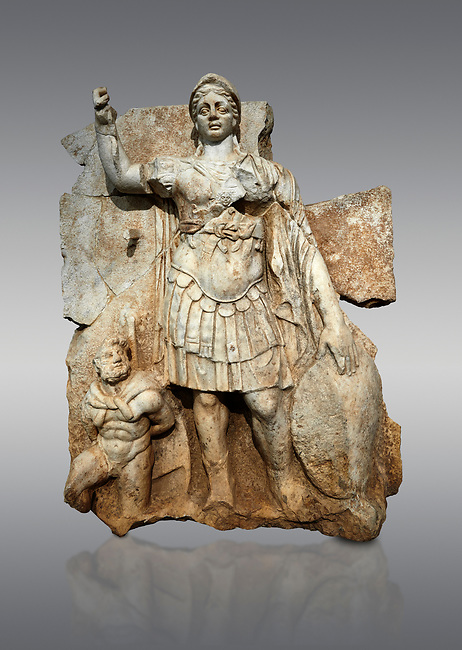 Roman Sebasteion relief  sculpture of Roma armed, Aphrodisias Museum, Aphrodisias, Turkey. <br /> <br /> Roma is equipped with a spear, helmet, round shield and imperial style armour. Blow crouches a naked bearded prisoner, with hands tied behind his back and a skin knotted around his neck. He turns to look up at Roma