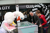 Chris Pearlman plays table soccer against Cyril and Cybil the Swans mascots during the Swansea City FC shop opening in Union Street, Swansea, Wales, UK. Saturday 07 October 2017