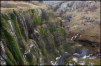 BNPS.co.uk (01202 558833)<br /> Pic: PhilYeomans/BNPS<br /> <br /> The freezing weather has added fresh impetus to  the annual 'Spring clean' of the huge cliffs at Cheddar Gorge in Somerset this year.<br /> <br /> The 400ft high limestone cliffs have to be scaled by a crack team of Rope Access Technicians to clear them of weeds and loose rocks to protect visitors to the bottom of the historic gorge.