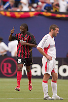 The MetroStars' Fabian Taylor celebrates scoring his first goal of the game as D.C. United's Ben Olsen stands with his hands on his hips. D. C. United was defeated by the NY/NJ MetroStars 3 to 2 during the MetroStars home opener at Giant's Stadium, East Rutherford, NJ, on April 17, 2004.