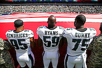 Mychal Kendricks, DeMeco Ryans, and Vinny Curry hold the American Flag before a game vs the Jacksonville Jaguars at Lincoln Financial Field on September 7, 2014 in Philadelphia, Pennsylvania. The Eagles won 34-17. (Photo by Hunter Martin/Philadelphia Eagles