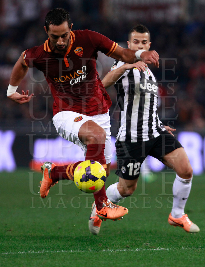 Calcio, quarti di finale di Coppa Italia: Roma vs Juventus. Roma, stadio Olimpico, 21 gennaio 2014.<br /> AS Roma defender Mehdi Benatia, of Morocco, is challenged by Juventus forward Sebastian Giovinco, right, during the Italian Cup round of eight final football match between AS Roma and Juventus, at Rome's Olympic stadium, 21 January 2014.<br /> UPDATE IMAGES PRESS/Isabella Bonotto