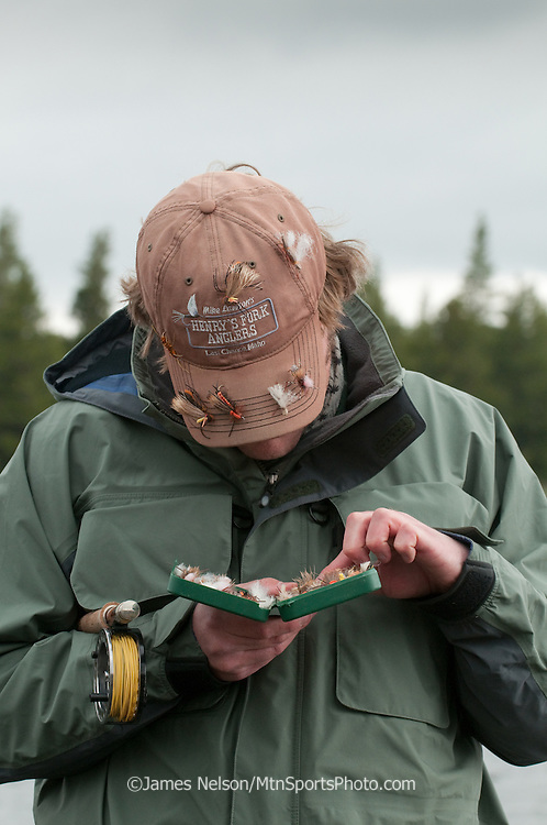 Hootie Mauldin chooses a salmon fly (a.k.a., stone fly) pattern to catch a trout on the Henry's Fork (a.k.a., North Fork) of the Snake River, Idaho.
