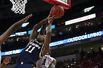 25 January 2015: NC State's Trevor Lacey (1) blocks a shot by Notre Dame's Demetrius Jackson (11). The North Carolina State University Wolfpack played the University of Notre Dame Fighting Irish in an NCAA Division I Men's basketball game at the PNC Arena in Raleigh, North Carolina. Notre Dame won the game 81-78 in overtime.