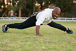 African American man doing one arm push-ups