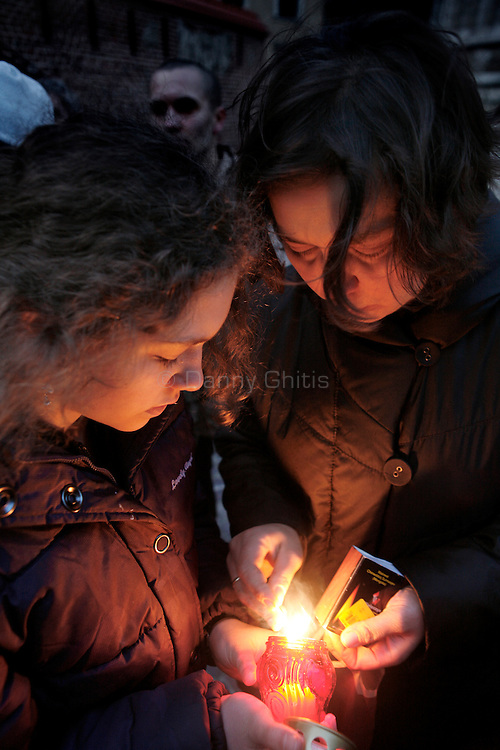 A mother and daughter light vigil candles in the Krakow city center in honor of Polish President Lech Kaczynski. He and many of the country's top leaders were killed in a plane crash Saturday morning on route to the site of a Soviet massacre of Polish officers during World War II. . April 10, 2010