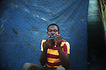 ZANZUR, Libya 5th September 2011:..A Liberian shaves using a shard of mirror. ...Ayman Oghanna