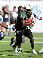 Miami Central Rockets running back Joseph Yearby #22 runs upfield on a 7 yard touchdown run during the second quarter of the Florida High School Athletic Association 6A Championship Game at Florida's Citrus Bowl on December 17, 2011 in Orlando, Florida.  The score at halftime is Armwood 16 - Miami Central 14.  (Mike Janes/Four Seam Images)