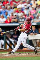 Arkansas Razorbacks outfielder Andrew Benintendi (16) swings the bat against the Virginia Cavaliers in Game 1 of the NCAA College World Series on June 13, 2015 at TD Ameritrade Park in Omaha, Nebraska. Virginia defeated Arkansas 5-3. (Andrew Woolley/Four Seam Images)