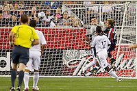 New England Revolution forward Taylor Twellman (20) collides with Los Angeles Galaxy goalkeeper Steve Cronin (1) as Twellman's header flies into the net for the first goal during the first half of an MLS regular season match between the New England Revolution and the Los Angeles Galaxy at Gillette Stadium in Foxborough, MA, on August 30, 2008.
