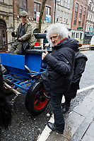 Pictured: Brian May climbs on a horse cart. Thursday 26 December 2019<br /> Re: Guitarist Brian May of Queen has joined the Boxing Day Hunt in Wind Street, Swansea, Wales, UK.