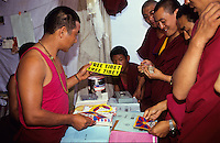 "INDIA, Karnataka, Bylakuppe, tibetan buddhist in refugee settlements, monks sell Free Tibet sticker and leaflets / INDIEN, Bylakuppe, tibetische buddhistische Moenche in den tibetischen Fluechtlings-Siedlungen ""Lugsum Samdupling"", gegruendet 1960 und ""Dickyi Larsoe"", gegruendet 1969"