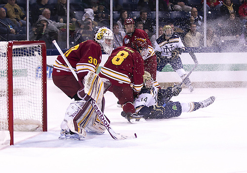 January 25, 2013:  Ferris State center Cory Kane (8) and Notre Dame center Thomas DiPauli (14) battle during NCAA Hockey game action between the Notre Dame Fighting Irish and the Ferris State Bulldogs at Compton Family Ice Arena in South Bend, Indiana.  Ferris State defeated Notre Dame 3-1.