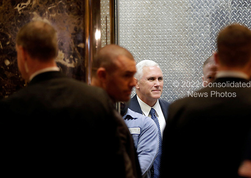United States Vice President-elect Mike Pence stands in the elevator in the lobby of Trump Tower on November 29, 2016 in New York City.    <br /> Credit: John Angelillo / Pool via CNP