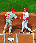 13 April 2009: Washington Nationals' Manager Manny Acta shakes hands at home plate with Philadelphia Phillies Manager Charlie Manuel prior to the Nats' Home Opener at Nationals Park in Washington, DC. The Nats fell short in their 9th inning rally, losing 9-8, and marking their 7th consecutive loss of the 2009 season. Mandatory Credit: Ed Wolfstein Photo