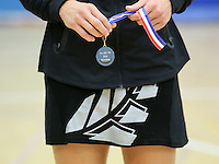 20.1.2014 New Zealand's Laura Lagman holds her winners medal at the end of the netball test match with England in London, England. Mandatory Photo Credit (Pic: David Klein). ©Michael Bradley Photography.