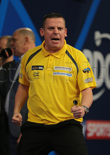 30.12.2015. Alexandra Palace, London, England. William Hill PDC World Darts Championship. Dave Chisnall looks to his supporters corner and punches the air after throwing a 180