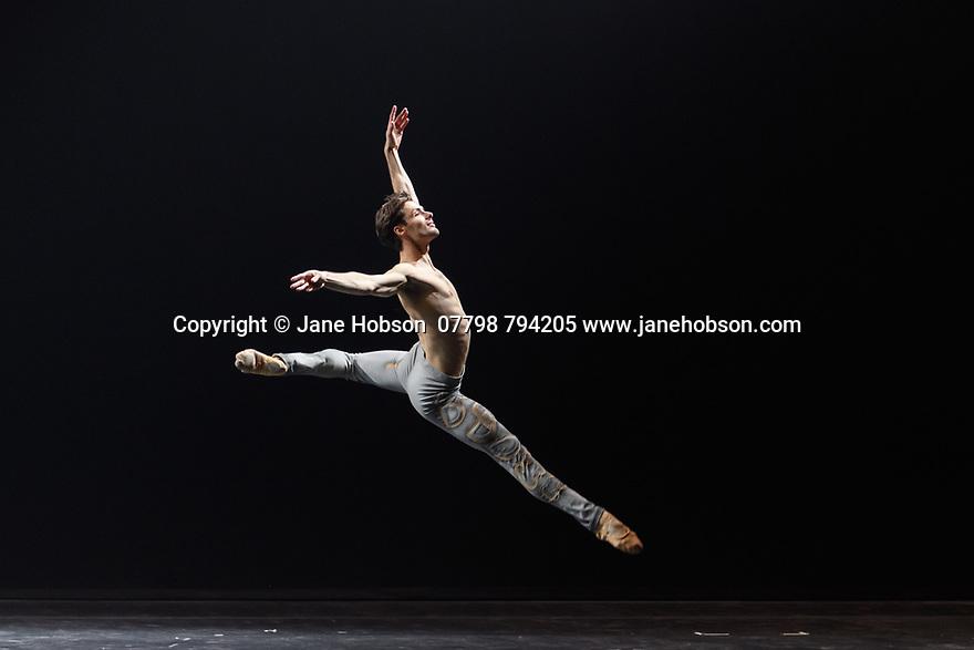 "London, UK. 02.12.19. Svetlana Zakharova, the Bolshoi's Prima and the first and only Russian Etpile at Teatro alla Scala, returns to the London Coliseum, with MODANSE, a new double bill produced by Muzarts. Zakharova is joined on stage by a cast of dancers from the Bolshoi Ballet, including Mikhail Lobukhin, Vaycheslav Lopatin, Denis Savin, Jacopo Tissi and Ana Turazashvili. The piece shown is: 'Come un Respiro"" (Like a Breath), choreographed by Mauro Bigonzetti, in its UK premiere. The dancers are: Svetlana Zakharova, Denis Savin, Jacopo Tissi, Mikhail Lobukhin, Vyacheslav Lopatin, Ana Turazashvili, Anastasia Stashkevich, Victoria Litvinova, Marfa Fyodorova, Tatiana Osipova, Anita Pudikova, Anna Zakaraya, Karim Abdullin, Alexei Gaynutdinov, Anton Gaynutdinov. Picture shows: Jacopo Tissi. Photograph © Jane Hobson."