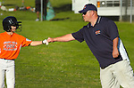 Jersey Shore GSV player receives a fist bump from his coach after a single.