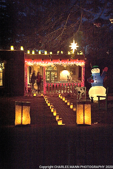 Faralitos and luminarias are traditional Christmas lights that decorate the streets and walls of Canyon Road and other parts of the east side of the city of Santa Fe, New Mexico on Christmas Eve.